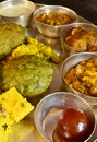 Traditional indian vegeterian platter consisting of different curries roti and sweet Stock Photo