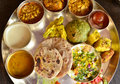 Traditional indian vegeterian platter consisting of different curries roti and sweet Royalty Free Stock Photography