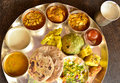 Traditional indian vegeterian platter consisting of different curries roti and sweet Royalty Free Stock Photo