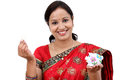 Traditional Indian woman holding a piggy bank