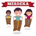 Traditional Indonesian special game on Independence Day, children race in sacks. Merdeka Day is Indonesian Independence Day. Royalty Free Stock Photo