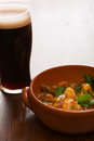 Traditional Irish Stew and a pint of beer in backlit Royalty Free Stock Photo