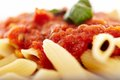 Traditional italian pasta with tomato and pepperoni sauce decora closeup of decorated basil selective focus Stock Photo