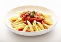 Traditional italian pasta with tomato sauce and basil closeup of peperoni penne arrabbiata isolated on white bakground Royalty Free Stock Photos