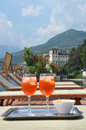Traditional italian spritz cocktail against lake como italy Royalty Free Stock Photos