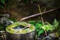 Traditional japanese bamboo fountain at Ryoan-ji temple in Kyoto, Japan Royalty Free Stock Photo