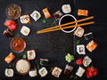 Traditional Japanese food - sushi, rolls and sauce on a dark background. Royalty Free Stock Photo