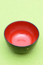 Traditional japanese rice bowl on green background Stock Photography