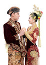 Traditional java wedding couple husband and wife hold each other isolated over white background Royalty Free Stock Images