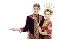 Traditional java wedding couple husband and wife presenting blan blank area isolated over white background Stock Photos
