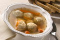 Traditional jewish passover dish matzah ball soup served with rye bread Stock Photo