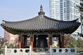 Traditional korean ceremonial building on a background of modern city buildings Royalty Free Stock Photography