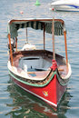 Traditional luzzu boat malta a is a fishing from the maltese islands they are brightly painted in shades of yellow red green and Royalty Free Stock Images