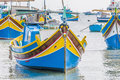 Traditional luzzu boat at marsaxlokk harbor a fishing village located in the south eastern part of malta Royalty Free Stock Images