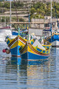 Traditional Luzzu boat at Marsaxlokk harbor in Malta. Stock Image