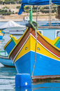 Traditional Luzzu boat at Marsaxlokk harbor in Malta. Royalty Free Stock Photos