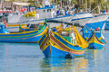 Traditional luzzu boat at marsaxlokk harbor in malta a fishing village located the south eastern part of Stock Photos