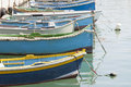 Traditional luzzu boats malta a is a fishing boat from the maltese islands they are brightly painted in shades of yellow red green Royalty Free Stock Images