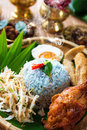 Traditional malaysian food nasi kerabu is a type of ulam popular malay rice dish blue color of rice resulting from the petals Stock Photos