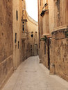 Traditional maltese alleyway triq san pietru mdina the old capital of malta is a typical mediaeval town surrounded by a defensive Stock Photos