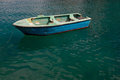 Traditional maltese boat in a popular and quaint harbor village in malta Royalty Free Stock Image