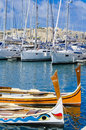 Traditional maltese boats wooden berthed at the cottoneera marina on the island of malta Stock Images