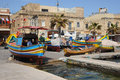 Traditional maltese luzzu fishing boats in marsaxlokk harbor mediterranean island of malta march Stock Images