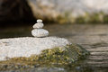 Traditional meditation zen stones design on a river three balancing structure Stock Image