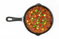 Traditional mexican tex mex chili con carne in a frying pan isolated Royalty Free Stock Photo