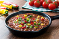 Traditional mexican tex mex chili con carne in a frying pan on wood Royalty Free Stock Photo