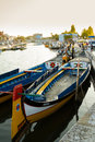Traditional moliceiro boats in the canal of Aveiro city, in Port Stock Images
