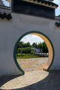 Traditional moon gate to chinese garden a entrance the Stock Images
