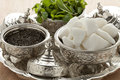 Traditional moroccan bowls with sugar mint and tea set in Stock Images