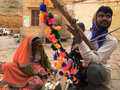 Traditional musical instrument seller playing stringed instrument jaisalmer rajasthan india december jaisalmer people tried to Royalty Free Stock Image