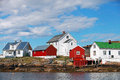 Traditional norwegian coastal fishing village with red and white wooden houses Royalty Free Stock Photo
