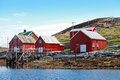 Traditional norwegian coastal village with red wooden houses Royalty Free Stock Image