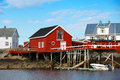 Traditional norwegian coastal village wooden houses on rocky coast Royalty Free Stock Photos