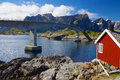 Traditional norwegian fishing house and bridge connecting islands on lofoten in norway Royalty Free Stock Images