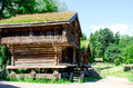 Traditional norwegian wooden log house with grass on a roof old Stock Photo