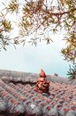 Traditional Okinawa local house tile roof with Shisa sculpture