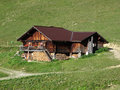 Traditional old farm house in the bernese oberland swiss alps Stock Photography