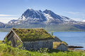 Traditional old wooden houses in a fishing village in northern Norway Royalty Free Stock Photo
