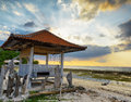 Traditional pavillion on sunset beach Royalty Free Stock Images