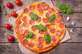 Traditional pepperoni pizza Italian delicious meal Royalty Free Stock Photo