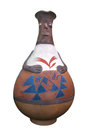 Traditional peruvian indian pottery isolated decorated pitcher in the stylized shape of a woman on white Royalty Free Stock Images