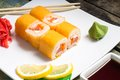 Traditional philadelphia sushi rolls on white plate with wasabi chopstick and Stock Photos