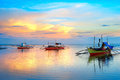 Traditional philippines boats landscape with at sunset Royalty Free Stock Photos