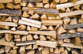 Traditional pile of chopped fire wood with a rustic rural look Stock Image