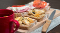 Traditional polish supper sandwiches with herring ham cottage cheese and tea with lemon Royalty Free Stock Photo