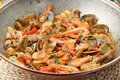 Traditional portuguse seafood dish cataplana the cooking process used by the prevents the loss of the ingredients aromas Royalty Free Stock Image